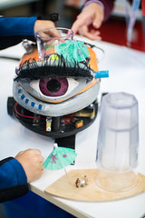 Creepy robot with a giant eye (Ivan Radic) Tags: austria creepy makerfair roboter vienna wien gianteye grosesauge gruselig robot österrreich canoneosm50 canonef50mmf14usm speedbooster viltroxefeosm2 viltroxefeosm2071x ivanradic