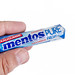 Mentos Chewing Gums in the hand above white background