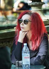 Portrait (D80_520180) (Itzick Away (until 1st. Oct.)) Tags: nyc bryantpark manhattan candid color colorportrait redhead redhair streetphotography shades water bottle table portrait face facialexpression d800 itzick