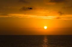 Sunset Chopper 2 (elektron9) Tags: california southwest cali ca us usa america sandiego san diego westcoast sunset orange blue purple sun clouds water ocean pacificocean shoreline beach lajolla la jolla cove straight lines goldenhour glow sky sea