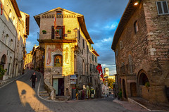 Left or Right (Mr.Dare) Tags: assisi umbria italia italy medieval architecture building narrowstreet street flags contrada sunset sunlight dusk twilight houses