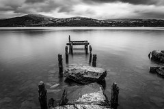old jetty (Tobias Hahn) Tags: jetty black white blackwhite lake water hill fell long time exposure clouds landscape wood lte filter nd