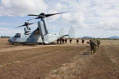 "Marines load into an MV-22B Osprey tiltrotor aircraft (#PACOM) Tags: japan ready okinawa marinecorps 31stmeu indopacific lhd1 7thfleet vmfa121 2ndbattalion battalionlandingteam 31stmarineexpeditionaryunit amphibiousassaultshipusswasplhd1 lsd48 partnered 1stmarines blt21 groundcombatelement iiimef iiimarineexpeditionaryforce lpd20 combatlogisticsbattalion31 clb31 commandelement aviationcombatelement logisticscombatelement marinemediumtiltrotorsquadron265reinforced vmm265rein docklandingshipussashlandlsd48 amphibioustransportdockussgreenbaylpd20 australia queensland bowen lethal talismansabre magtf talismansaber ts19 marineairgroundtaskforce ch53esuperstallionhelicopter f35blightningii mv22bospreytiltrotoraircraft hmascanberral02 ah1zviperhelicopter uh1yhvenomhelicopter ""usindopacificcommand usindopacom"""