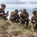 Marines assess a terrain map during a simulated amphibious assault of exercise Talisman Sabre 19