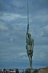Verity (janedoe.notts) Tags: england unitedkingdom sculpture statue sword woman harbour clouds sky justice truth ilfracombe olympus 12100 em10markii