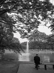 solitude in a park (peaceblaster9) Tags: park solitude fountain pond tree alone 公園 一人の時間 噴水 池 独り 東京 代々木公園 tokyo blackandwhite bnw bw blackwhite monochrome モノクローム モノクロ 白黒