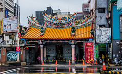 2019 - Taiwan - Keelung - 9 - Cheng Huang Temple (Ted's photos - For Me & You) Tags: 2019 cropped keelung nikon nikond750 nikonfx taipei taiwan tedmcgrath tedsphotos vignetting chenghuangtemple keelungchenghuangtemple chenghuangtemplekeelung temple streetscene street pylons reflection crosswalk red redrule