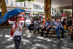 Umbrella (timnutt) Tags: x100t munchen street people fuji bavaria munich city x100 fujifilm germany