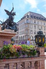 Bavarian Busker (timnutt) Tags: x100t munchen street people fuji bavaria munich city x100 fujifilm germany