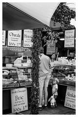 Child and hare (timnutt) Tags: trader market street people germany munich nikcollection fujifilm sales x100t selling munchen food monochrome mono x100 bw fuji bavaria silverefexpro2 blackandwhite city