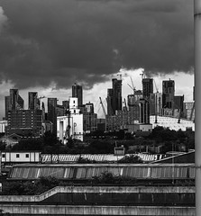 Silvertown (KitsuneUK) Tags: london rooftop city cityscape street architecture architechture edits edit 1855 manual lightroom citylights skyscrapers sky england uk outdoor roof building road skyline urbex canon car skyscraper vibrant people water river tower bridge tree 50mm bnw blackandwhite