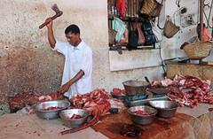 Hungry? - Public Market, Stonetown, Zanzibar (TravelsWithDan) Tags: hatchet man meat butcher candid africa tanzania zanzibar publicmarket bowls urban city canong3x african