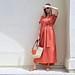 Beach Chalet Woman in Orange Dress