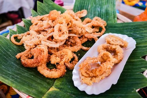 Deep fried calamares served on banana leaves