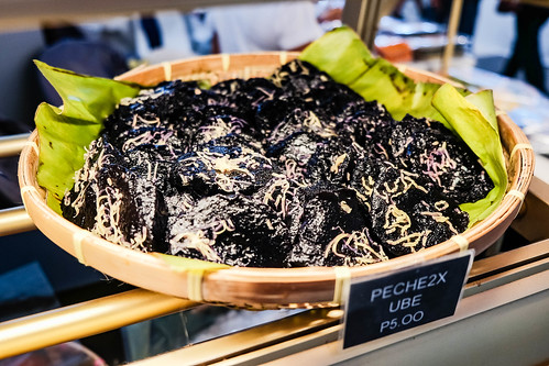 Peche ube with cheese toppings on display