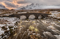 Ice and Fire (Pete Rowbottom, Wigan, UK) Tags: sligachan bridge skye isleofskye scottishhighlands scotlandlandscape sunrise sky clouds cuillin mountains scottishisles scottishmountains mountain range river water flow movement snow ice winter yellow red nisifilters nisis5 peterowbottom uk britain freezing