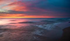 Dangerous Beauty (scott5024) Tags: sunset lake michigan water color landcsape waves long exposure dusk