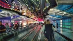 traveling in the real world.... (BillsExplorations) Tags: ohareairport transport 21stcentury terminal modern chicago illinois airport travel escalator neonlights vacation color