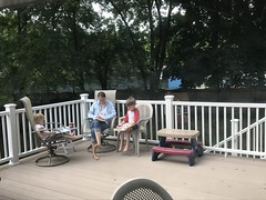 "Paul, Dani, and Mommy Reading on the Deck • <a style=""font-size:0.8em;"" href=""http://www.flickr.com/photos/109120354@N07/48388631152/"" target=""_blank"">View on Flickr</a>"