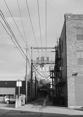 Utility Alley, Billings (LarsHolte) Tags: pentax 645 pentax645 645n 6x45 smcpentaxfa 75mm f28 120 film 120film analog analogue kosmo foto mono 100iso d76 mediumformat blackandwhite classicblackwhite bw monochrome filmforever filmphotography ishootfilm larsholte homeprocessing usa billings montana utility poles alley cityscape