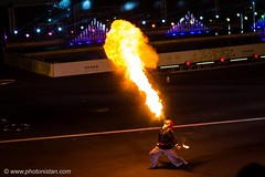 Risky Job - Street performer (Photonistan) Tags: photography photonistan fire obhur jeddahseason streetperformance riskyjob risk flames fossilfuels petrol benzeen crazytuesday yellow