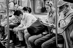 the ride uptown (susanjanegolding) Tags: earbuds manhattan brooklyn headphones wires wired smartphone tablet cell wireless commuters transportation technology passengers newyorkcity subway train publictransportation seventhavenueexpress irt broadway 123 mobile mobilephone device monochrome blackandwhite modernlife