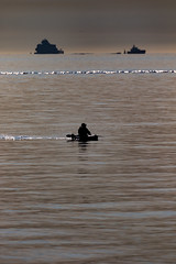 Loan Canoeist (tnxphotos) Tags: river humber cleethorpes sunset calm water seaside canoe watersports