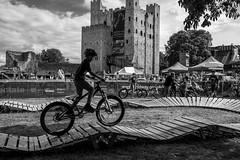 The Stunt Boy (daveseargeant) Tags: stuntman stunts bmx bike cycle boy monochrome contrast high black white blackwhite leica x typ 113 medway rochester kent british cycling championship weekend castle