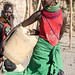 Turkana woman carrying water container