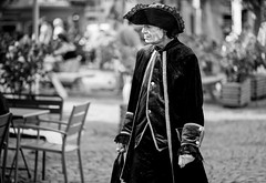 (graveur8x) Tags: man hat history historic bottle beer bier candid streetphotography portrait germany dof streetportrait streetartist urban blackandwhite monochrome contrast summer deutschland strase mann schwarzweis bw warm male costume sonya7iii sony sonyilce7m3 batis zeissbatis28135 zeiss