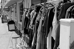 002 (amandawheadon) Tags: street photography sidewalk blackandwhite clothes dresses blouse hangers cocacola shoes chair downtown st johns newfoundland