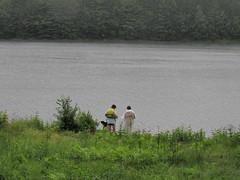 Corinna and Foresta Switching Life Jackets (amyboemig) Tags: beth bowman lake state park ny newyork camping kayaking kayak rain tandem corinna foresta