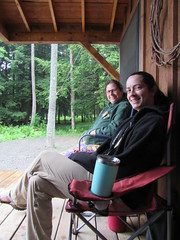 Foresta and Beth Enjoying Our Porch (amyboemig) Tags: beth bowman lake state park ny newyork camping foresta raining cabin