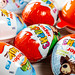Kinder surprises background - chocolate eggs and kinder joy