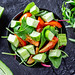 Vegetarian salad with tomatoes, cucumbers and herbs