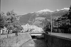 Chur (vladixp) Tags: ilford fp4 fp4plus fp480 d76 14min 20c 12 praktica mtl5 flektogon k2 pf7250u 3600dpi 35mm yellowfilter filmscan 35mmfilm film bw bwfilm filmphotography negative scanned graubünden grigioni grisons svizzera schweiz switzerland suisse chur calanda