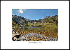 Natural Wonders of Wales - NDSC5315 (petersrockypics) Tags: llyn llynidwal cymru cwm cwmidwal ogwenvalley corrie cirque hangingvalley idwalslabs ygarn devilskitchen bluesky reflection rural reflections landscape lake clogwynygeifr castellygeifr twlldu scenery scenic snowdonia sky scenicwater countryside hillwalking hiking valley visitwales nikon nature nikond5200 northwales naturalcolours naturalbeauty natural charlesdarwin kase kasefilters kasek8 petersrockypicsnorthwales