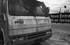 Abandoned truck (Manuel Goncalves) Tags: 35mmfilm blackandwhite nikonfg20 nikkor28mm analogue santos brazil epsonv500scanner rolleiretro400s city