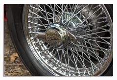 Classic Jaguar wheel. (johnhjic) Tags: johnhjic wheel polished polish spoke rubber silver shine shining jag chrome v12 e type jaguar british 1960 1960s car classic reflaction reflactions