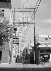 Alley with Utility Poles (LarsHolte) Tags: pentax 645 pentax645 645n 6x45 smcpentaxfa 75mm f28 120 film 120film analog analogue kosmo foto mono 100iso d76 mediumformat blackandwhite classicblackwhite bw monochrome filmforever filmphotography ishootfilm larsholte homeprocessing usa billings montana utility poles alley cityscape