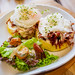 Close up of corned beef burger meal with poached egg