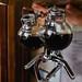 Brewed coffee inside glass bottles
