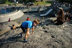 Climbing (dtanist) Tags: nyc newyork newyorkcity new york city sony a7 7artisans 35mm manhattan central park boulder rock outcrop visitors climb climbing boy children child kid