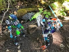 Ravage vs Fracture (Armored Toa) Tags: lego gen2 bionicle reaper scythe saw sniper gun axe halberd skeleton undead general warriors