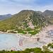 Aerial view of Punta Molentis Beach with a view to the Sarrabus Mountain, Sardinia, Italy