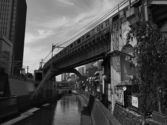 life with train and canal (peaceblaster9) Tags: river canal building bridge train shadow light tokyo blackandwhite bnw bw blackwhite monochrome 川 水路 ビル 橋 電車 生活 東京 影 光 モノクローム モノクロ 白黒