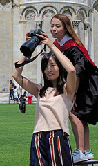 Model, reviewing her photographer's shot - Pisa, Italy (TravelsWithDan) Tags: youngwomen candid photographerandmodel friends tourists outdoors city urban streetphotography pisa italy europe canong3x holdinguptheleaningtowerimage theotherphotographer canoncamera showingwhatshephotographed