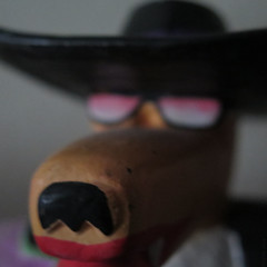 Zoot Suit Coyote (Coyoty) Tags: macromondays madeofwood square flickrfriday oldstyle bokeh macro zoot suit coyote zootsuit wood wooden old style black brown red pink sunglasses profile hat blackhat jazz jazzy squareformat face nose teeth colors markuspierson depth depthoffield dof