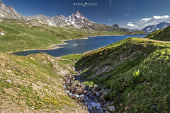 Lago Toggia - Alta Val Formazza (Italy) (Andrea Moscato) Tags: andreamoscato italia mountain montagna landscape light luce paesaggio parco park sky shadow cielo clouds nature natura nuvole natural naturale view vista vivid blue white green day snow alpi alps valle valley vallata ice stones rock hiking trail trekking panorama sentiero overlook lago lake water freshwater ombre flowers yellow