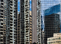 Meanwhile at the intersection...Skyscraper art (Picture-Perfect Pixels) Tags: alberta calgary abstract downtown reflectionsl skyscrapers distortions lines blues patterns repetition canada city cityscape concrete glass tall squares rectangles flickrexplorejuly292019